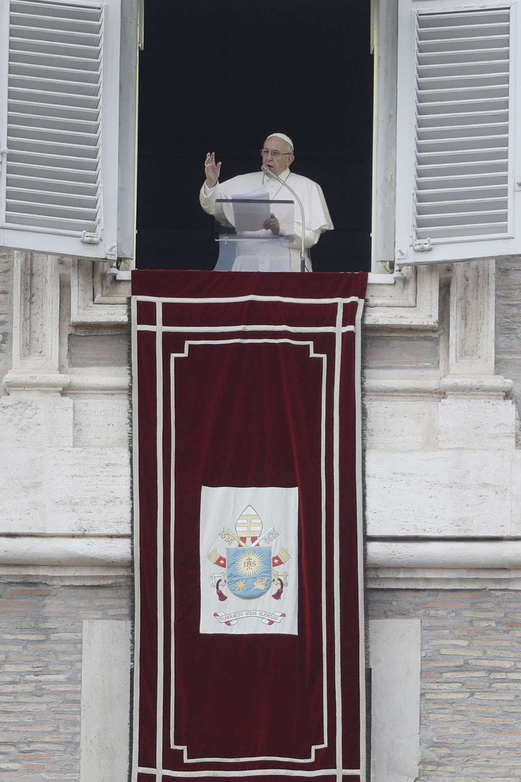 Pope Francis delivers his blessing during the Angelus noon prayer from his studio's window overlooking St. Peter's Square at the Vatican, Sunday, Nov....