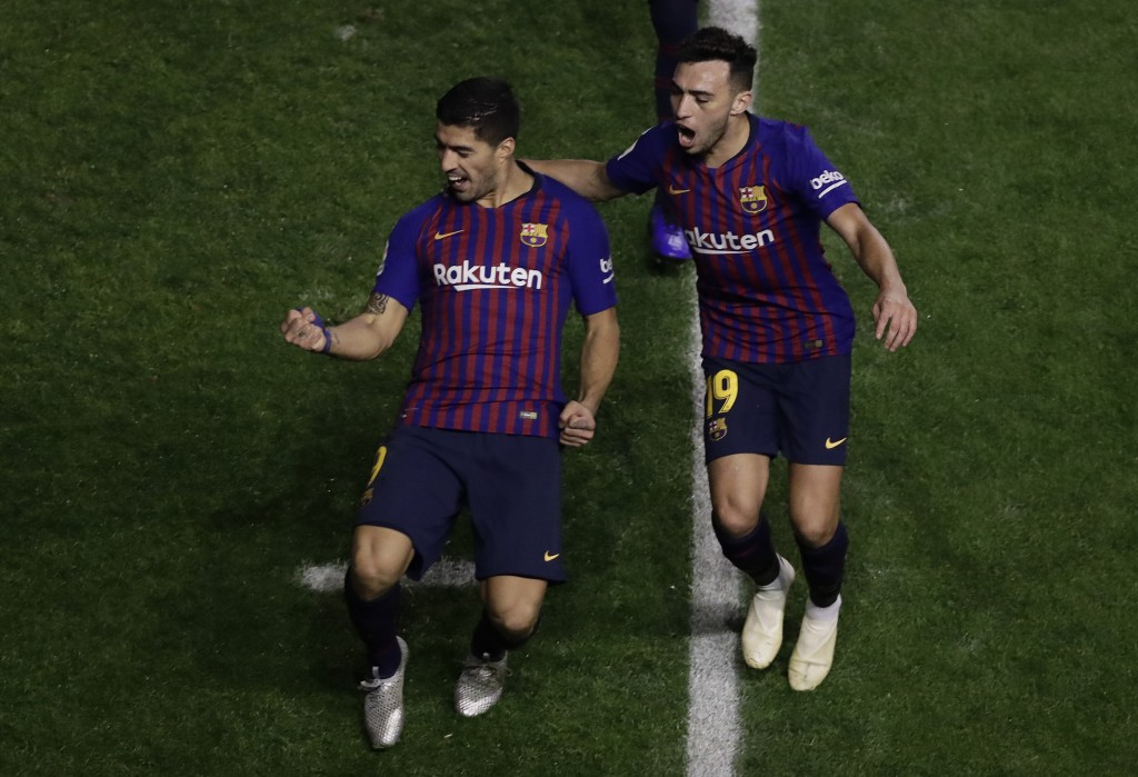 FC Barcelona's Luis Suarez celebrates after scoring during the Spanish La Liga soccer match between Rayo Vallecano and FC Barcelona at the Vallecas st
