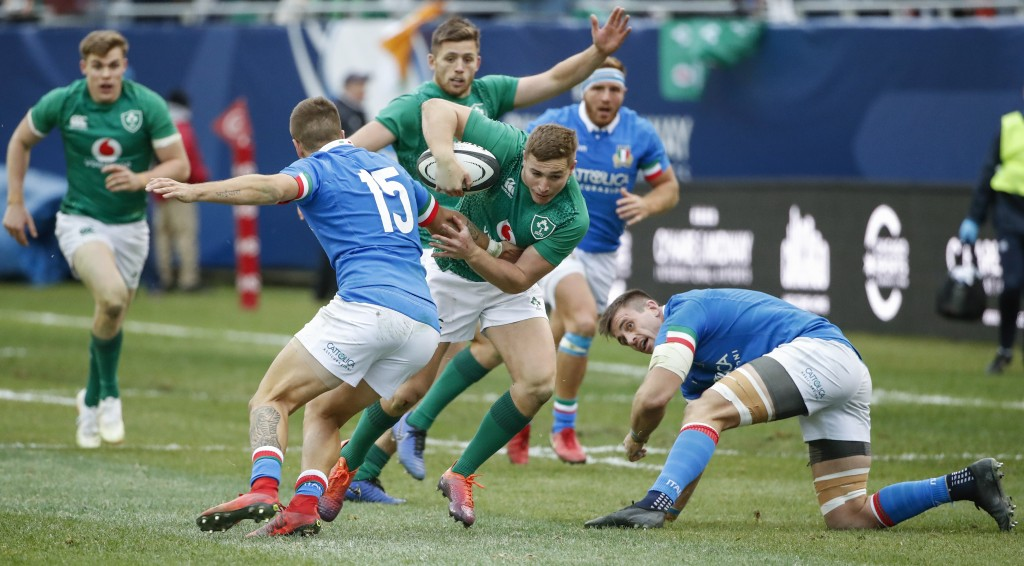 Ireland's Jordan Larmour, center, goes past Italy's Luca Sperandio, left, during the second half of rugby match Saturday, Nov. 3, 2018, in Chicago. (A