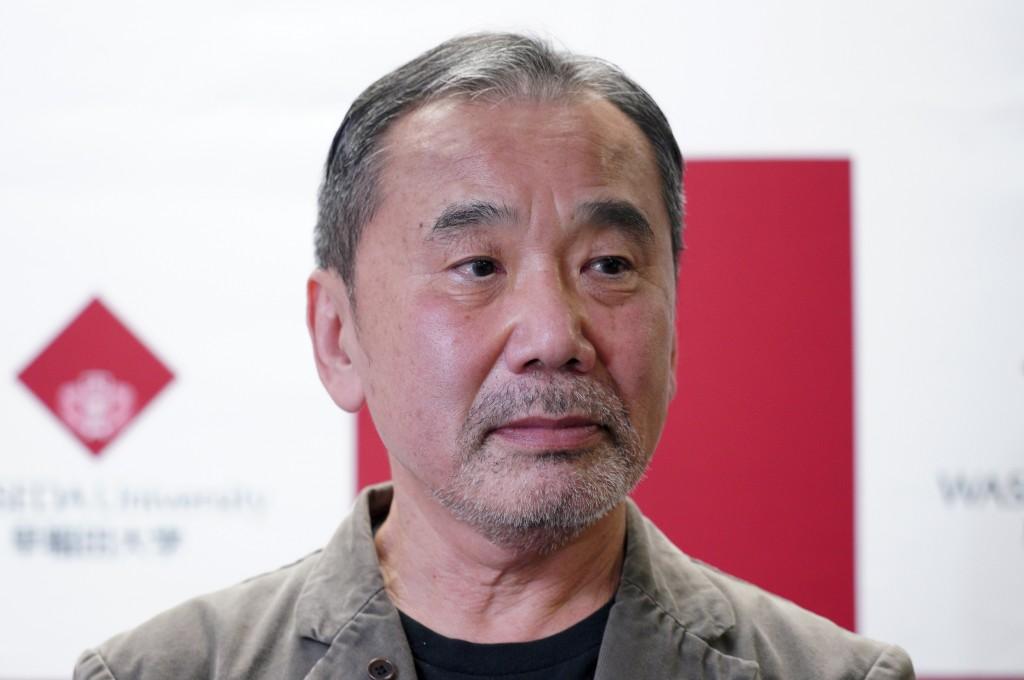 Japanese novelist Haruki Murakami attends a press conference at Waseda University in Tokyo Saturday, Nov. 3, 2018. (AP Photo/Eugene Hoshiko)