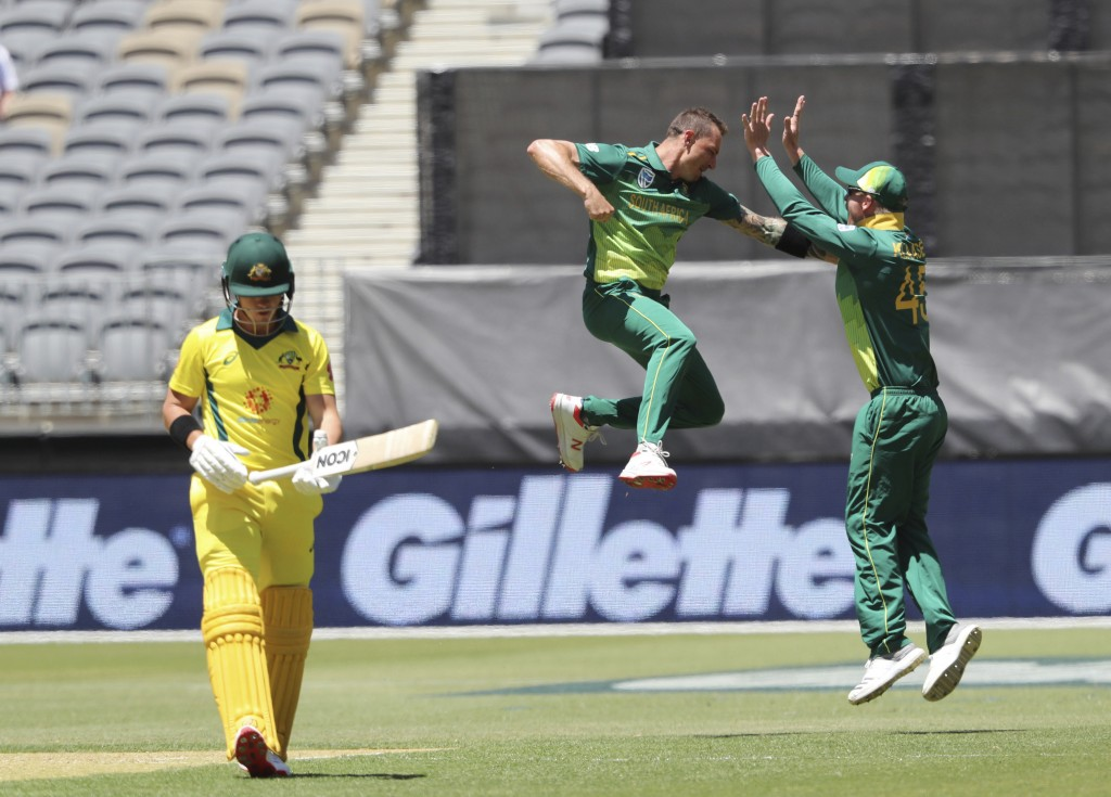 South Africa's Dale Steyn, center, celebrates with teammate Heinrich Klaasen after capturing the wicket of Australia's D'Arcy Short during their one d