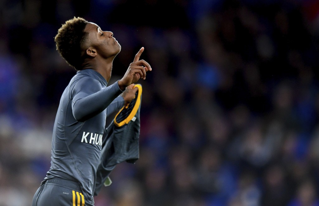 Leicester City's Demarai Gray with a shirt that reads 'For Khun Vichai' celebrates scoring his side's first goal of the game during the English Premie...