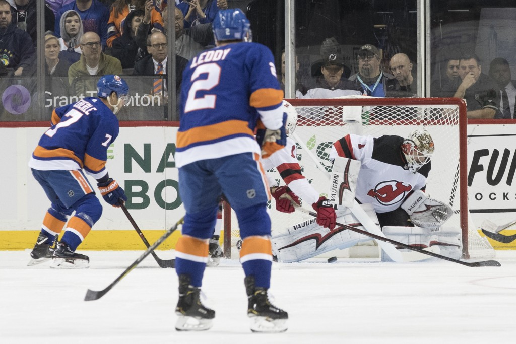 New York Islanders right wing Jordan Eberle (7) scores a goal past New Jersey Devils goaltender Keith Kinkaid (1) during the first period of an NHL ho...