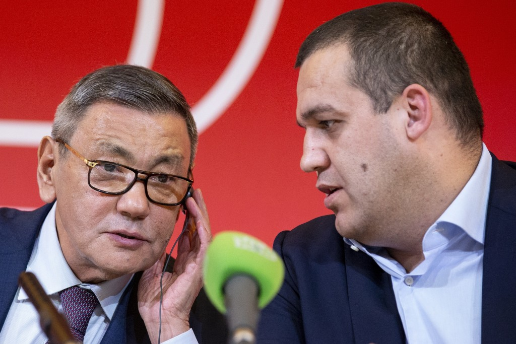 The new president of the amateur boxing federation Gafur Rakhimov, left, and Secretary General of the Boxing Federation of Russia Umar Kremlyov talk t
