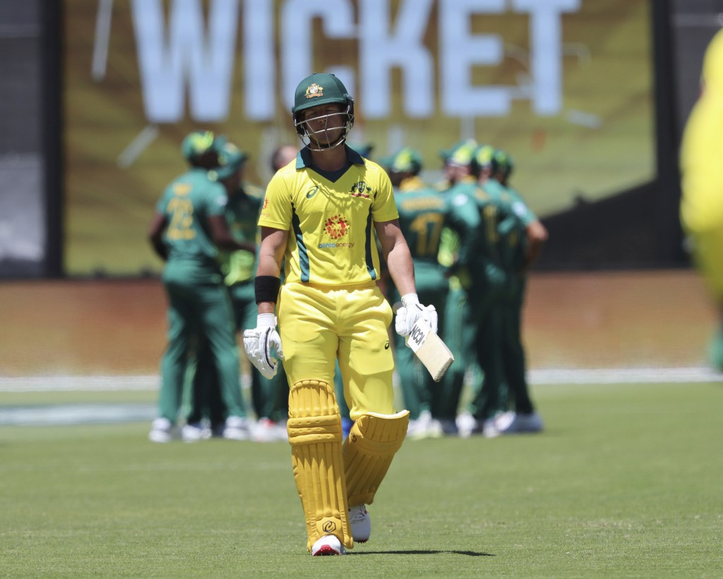 Australia's D'Arcy Short walks off after losing his wicket to South Africa's Dale Steyn during their one day international cricket match in Perth, Aus