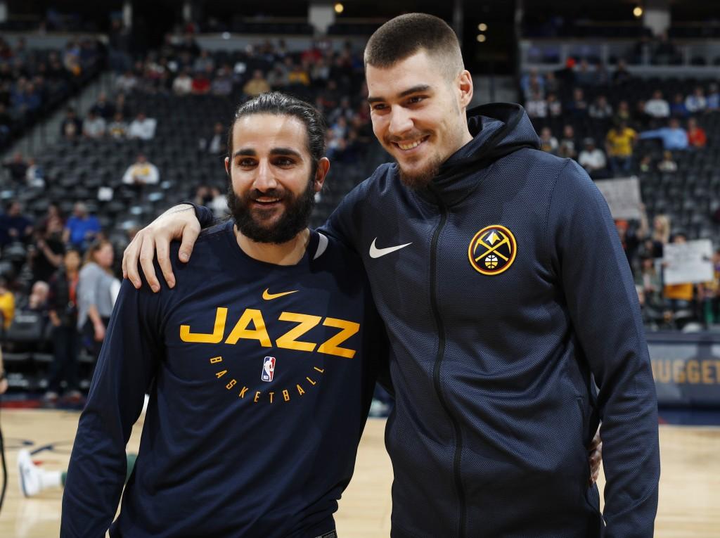 Utah Jazz guard Ricky Rubio, left, greets Denver Nuggets forward Juan Hernangomez, both of Spain, before an NBA basketball game Saturday, Nov. 3, 2018...