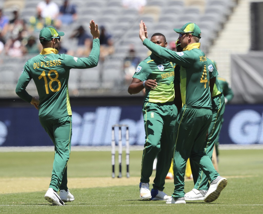 South Africa's Faf du Plessis, left, and Heinrich Klaasen celebrate the dismissal of Australia's Glenn Maxwell during their one-day international cric