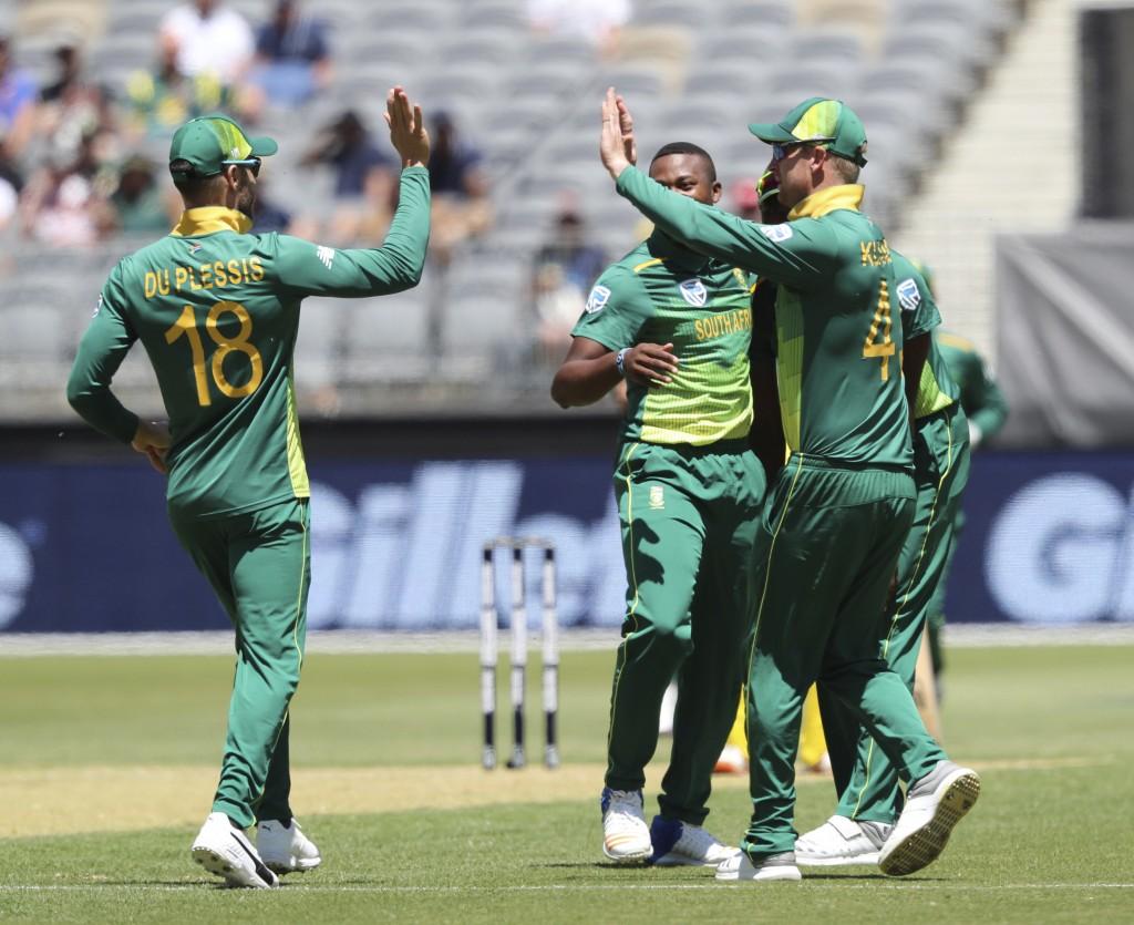 South Africa's Faf du Plessis, left, and Heinrich Klaasen celebrate the dismissal of Australia's Glenn Maxwell during their one-day international cric