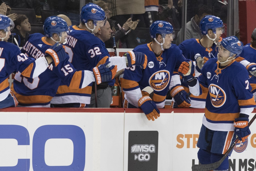 New York Islanders right wing Jordan Eberle (7) celebrates after scoring a goal during the first period of an NHL hockey game against the New Jersey D...