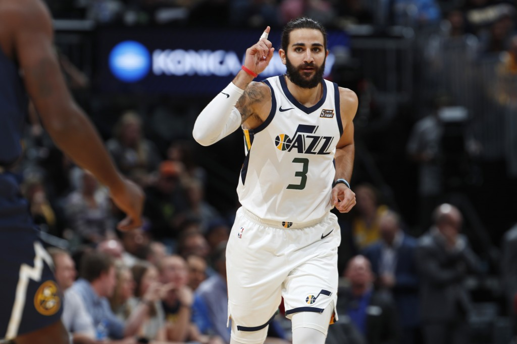 Utah Jazz guard Ricky Rubio gestures after hitting a basket against the Denver Nuggets during the first half of an NBA basketball game Saturday, Nov. ...