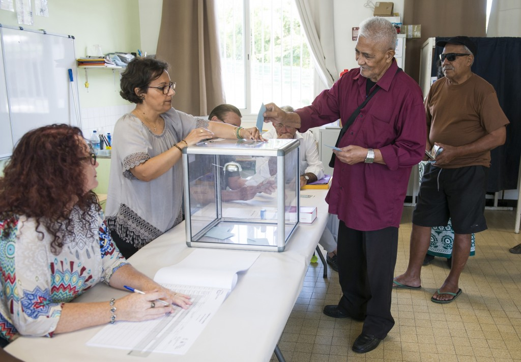 A resident of New Caledonia's capital, Noumea, casts his vote at a polling station as part of an independence referendum, Sunday, Nov. 4, 2018. Voters