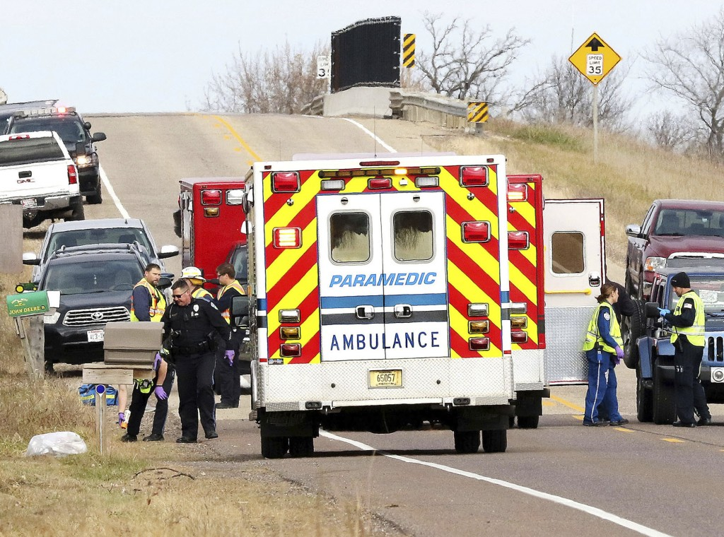 Emergency medical personnel gather at the scene of a hit-and-run accident Saturday, Nov. 3, 2018, in Lake Hallie, Wis., that killed two girls and an a
