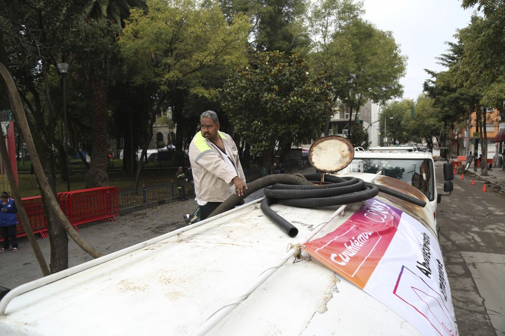 A Mexico City Water Systems employee fills up his water truck full of potable water in Mexico City, Saturday Nov. 3, 2018. Mexico City is currently on