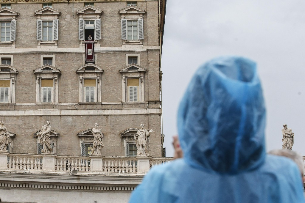 Pope Francis recites the Angelus noon prayer from his studio's window overlooking St. Peter's Square at the Vatican, Sunday, Nov. 4, 2018.  (Fabio Fru...