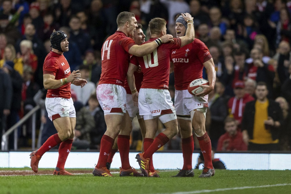 Wales' Jonathan Davies, right, celebrates scoring the second try against Scotland during the rugby union international match at The Principality Stadi