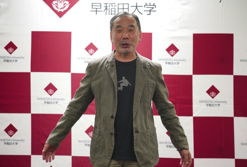 Japanese novelist Haruki Murakami poses for photographers during a press conference at Waseda University in Tokyo Saturday, Nov. 3, 2018. (AP Photo/Eu...