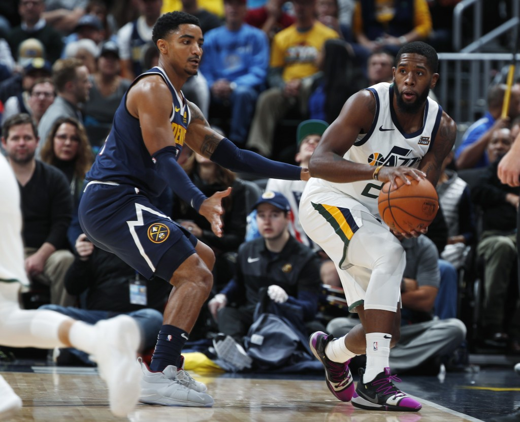 Utah Jazz forward Royce O'Neale, right, is defended by Denver Nuggets guard Gary Harris during the first half of an NBA basketball game Saturday, Nov.