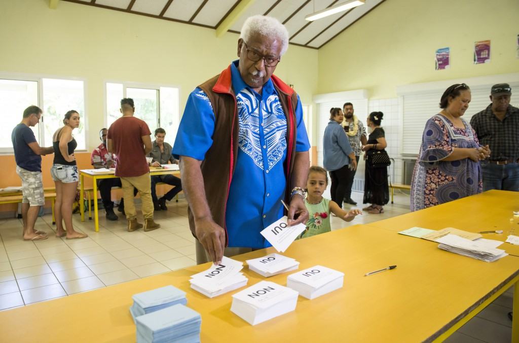 Roch Wamytan, a former leader of the independentist party, Union Caledonienne, prepares to cast his vote at a poling station in Le Mont-Dore, New Cale