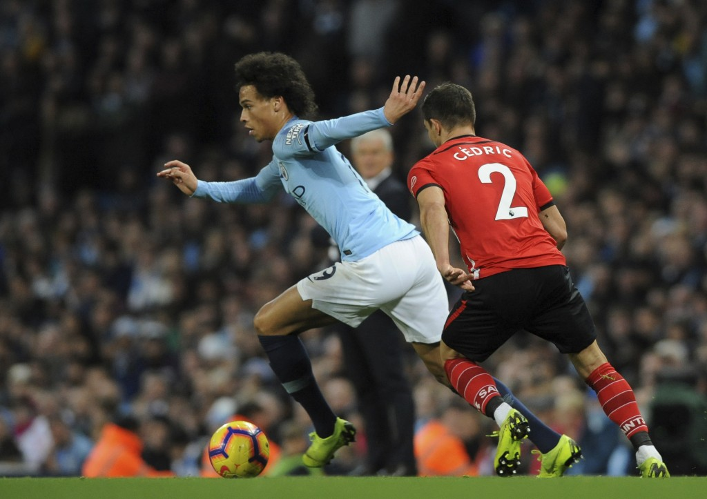 Manchester City's Leroy Sane, left, duels for the ball with Southampton's Cedric Soares during the English Premier League soccer match between Manches...