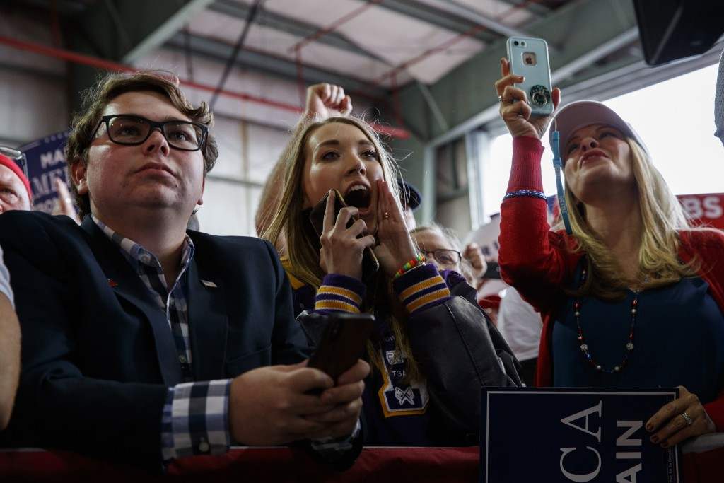 Supporters of President Donald Trump listen to him speak during a campaign rally, Sunday, Nov. 4, 2018, in Macon, Ga. (AP Photo/Evan Vucci)