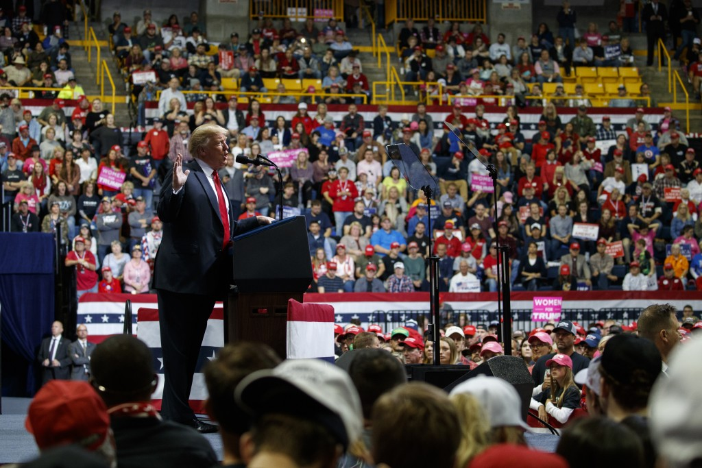 President Donald Trump speaks during a campaign rally, Sunday, Nov. 4, 2018, in Chattanooga, Tenn. (AP Photo/Evan Vucci)