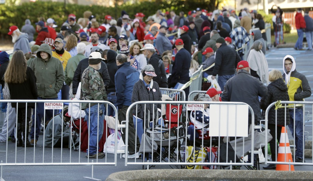 People wait in line outside McKenzie Arena in the early morning for a 7 p.m. rally by President Donald Trump Sunday, Nov. 4, 2018, in Chattanooga, Ten...