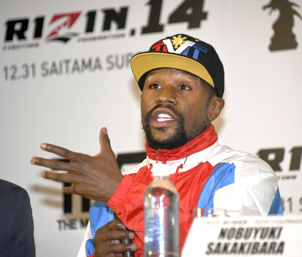 Floyd Mayweather of the U.S. speaks during a press conference in Tokyo, Monday, Nov. 5, 2018. Mayweather said he has signed to fight Japanese kickboxe...