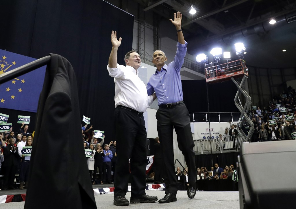 CORRECTS TO SAY THAT DONNELLY IS A CONGRESSIONAL CANDIDATE, NOT A GUBERNATORIAL CANDIDATE - Former President Barack Obama, right, and Democratic congr...
