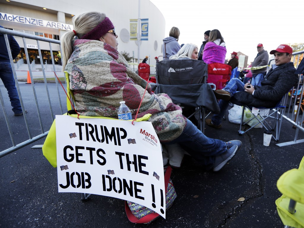 Casey Mchone waits outside McKenzie Arena for a campaign rally with President Donald Trump Sunday, Nov. 4, 2018, in Chattanooga, Tenn. Mchone arrived ...
