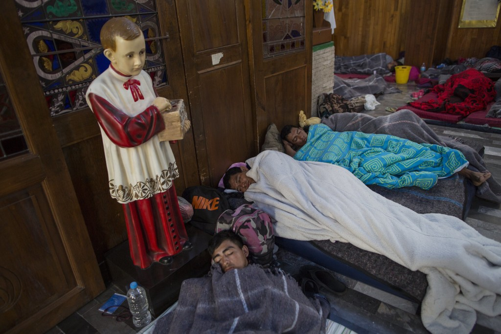 Central American migrants sleep inside a church that opened its doors to members of a caravan who splintered off the main group in order to reach the ...