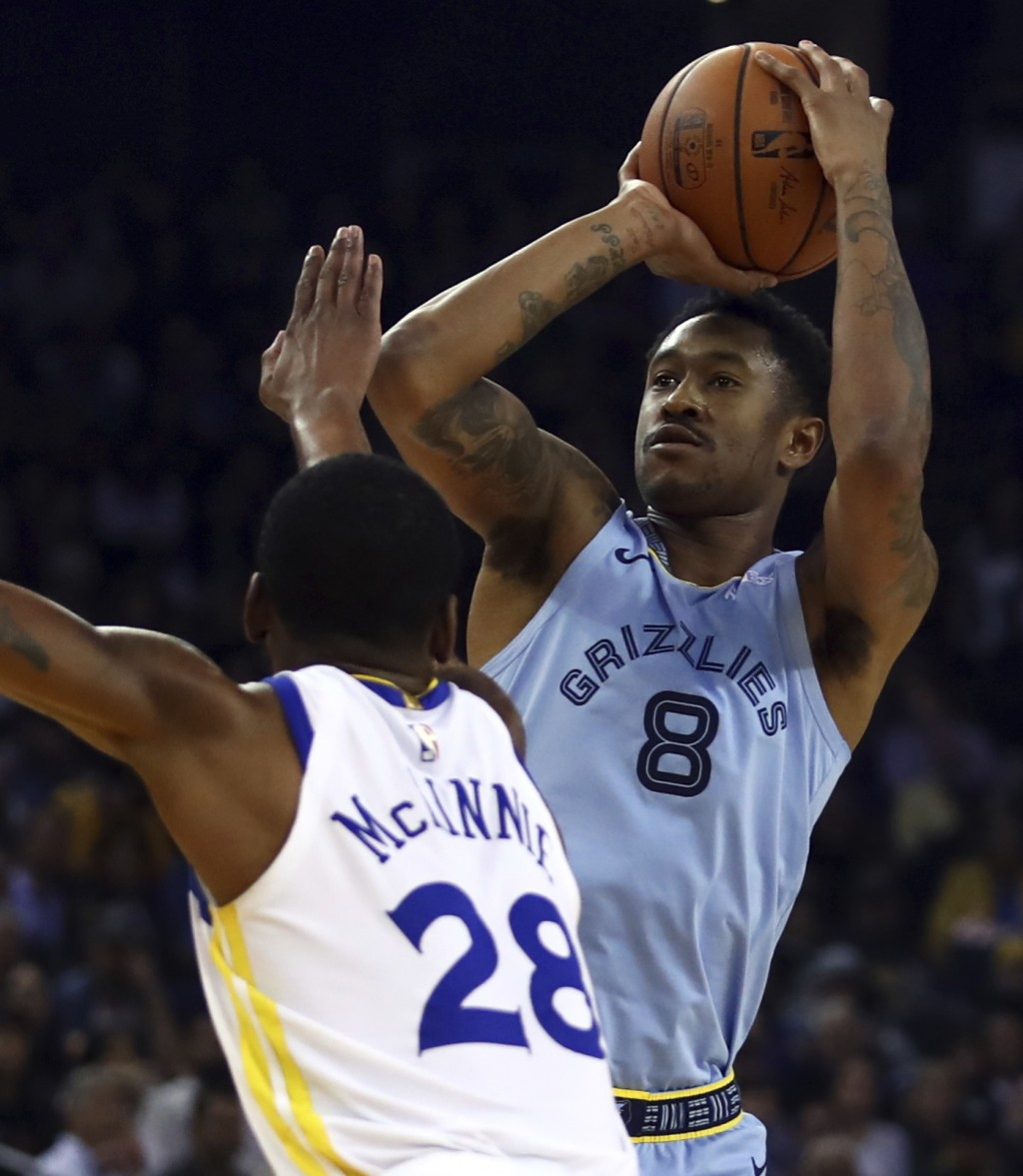 Memphis Grizzlies' MarShon Brooks, right, shoots over Golden State Warriors' Alfonzo McKinnie (28) during the first half of an NBA basketball game Mon