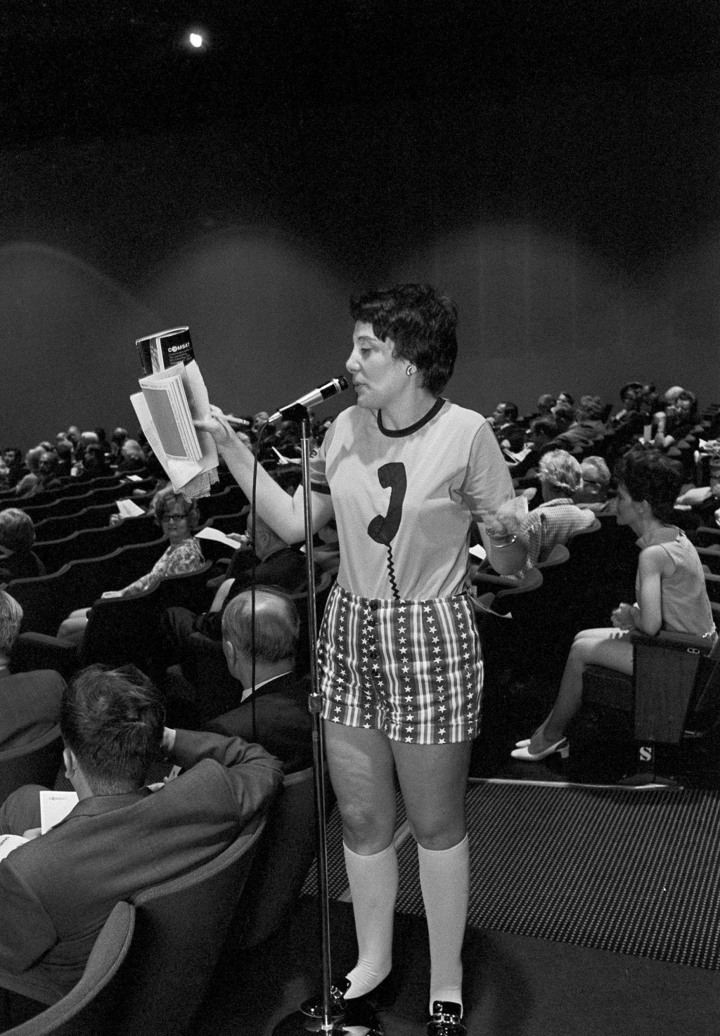 FILE - In this May 11, 1971 file photo, Evelyn Y. Davis wears hotpants as she speaks at the annual stockholders meeting of the Communications Satellit...