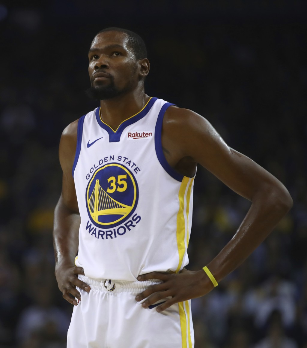 Golden State Warriors' Kevin Durant waits during a timeout during the first half of an NBA basketball game against the Memphis Grizzlies Monday, Nov. ...
