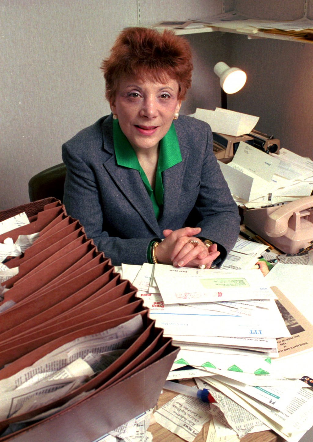 FILE- In this April 1990 file photo Evelyn Y. Davis, 60, poses for a photo in her Watergate Office Complex Suite in Washington. Davis, who owned stock