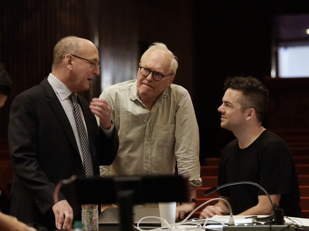 This Oct. 11, 2018 photo released by the Metropolitan Opera shows Composer Nico Muhly, right, with general manager Peter Gelb, left, and librettist Ni...