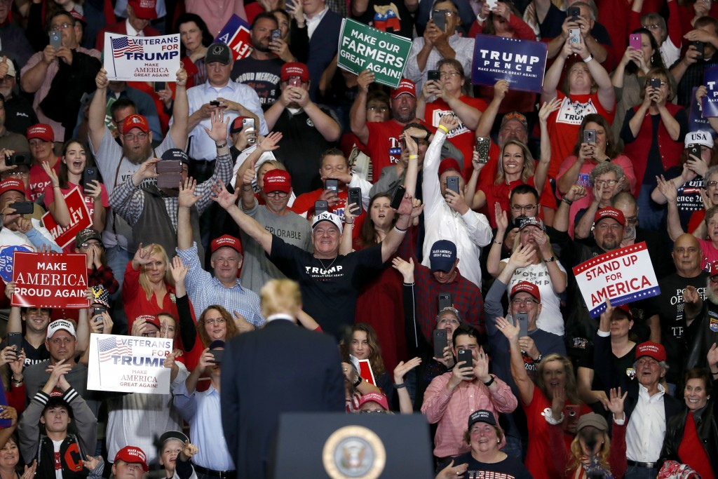 Members of the audience cheer as President Donald Trump leaves the stage at the end of a campaign rally Monday, Nov. 5, 2018, in Cape Girardeau, Mo. (