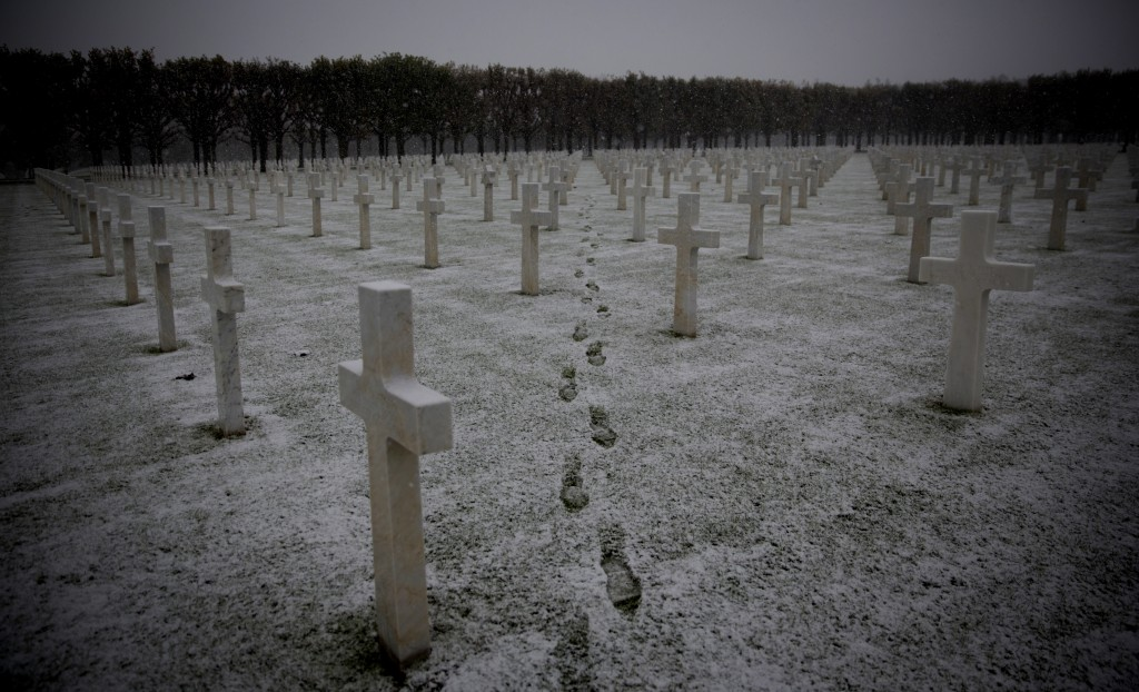 FILE In this Tuesday, Oct. 30, 2018 file photo, footsteps are seen as the snow falls at the Meuse-Argonne American World War I cemetery in Romagne-Sou