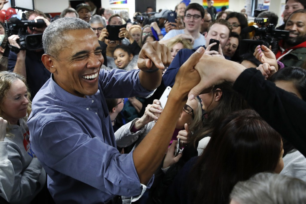 Former President Barack Obama smiles as he greets Democratic volunteers in a surprise appearance in Fairfax Station, Va., on Monday, Nov. 5, 2018. (AP...