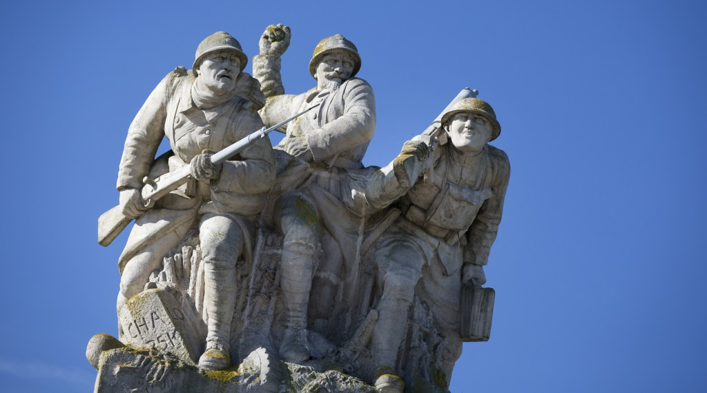 FILE  - In this Wednesday, Oct. 14, 2014 file photo, a statue of three soldiers at the World War I Navarin Memorial in Souain-Perthes-les-Hurlus, Fran