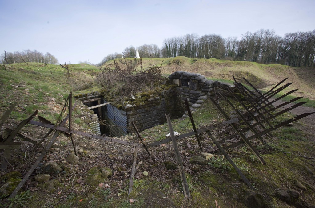 FILE - In this photo taken on Friday, March 24, 2017, barbed wire surrounds a World War I German trench line at the Mound of Vauquois in Vauquois, Fra