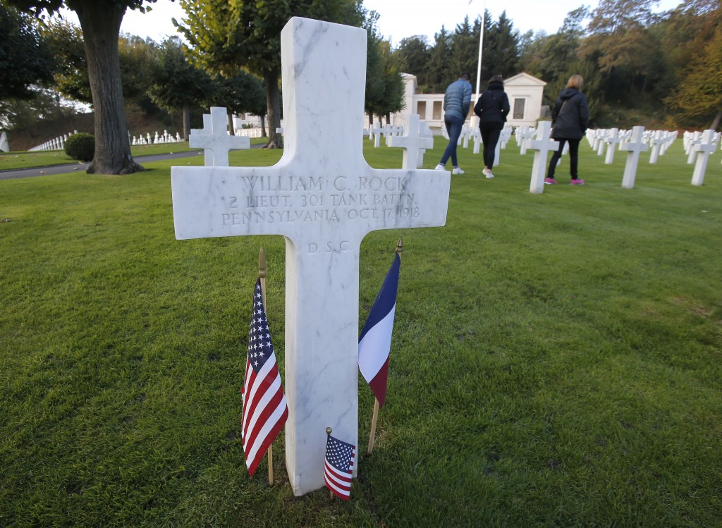 FILE _ In this file photo taken on Friday, Nov. 2, 2018, the grave of World War I officer William C. Rock from Pennsylvania is decorated with the Fren