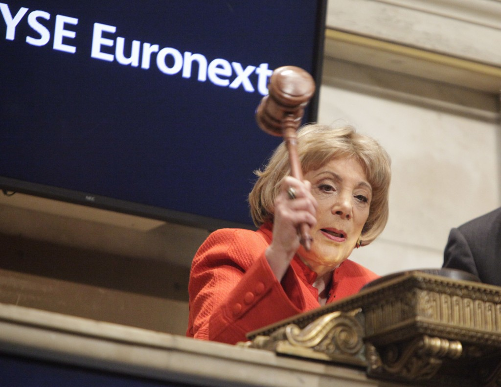 FILE - In this April 1, 2009, file photo, Evelyn Y. Davis uses a gavel to ring the closing bell at the New York Stock Exchange in New York. Davis, who