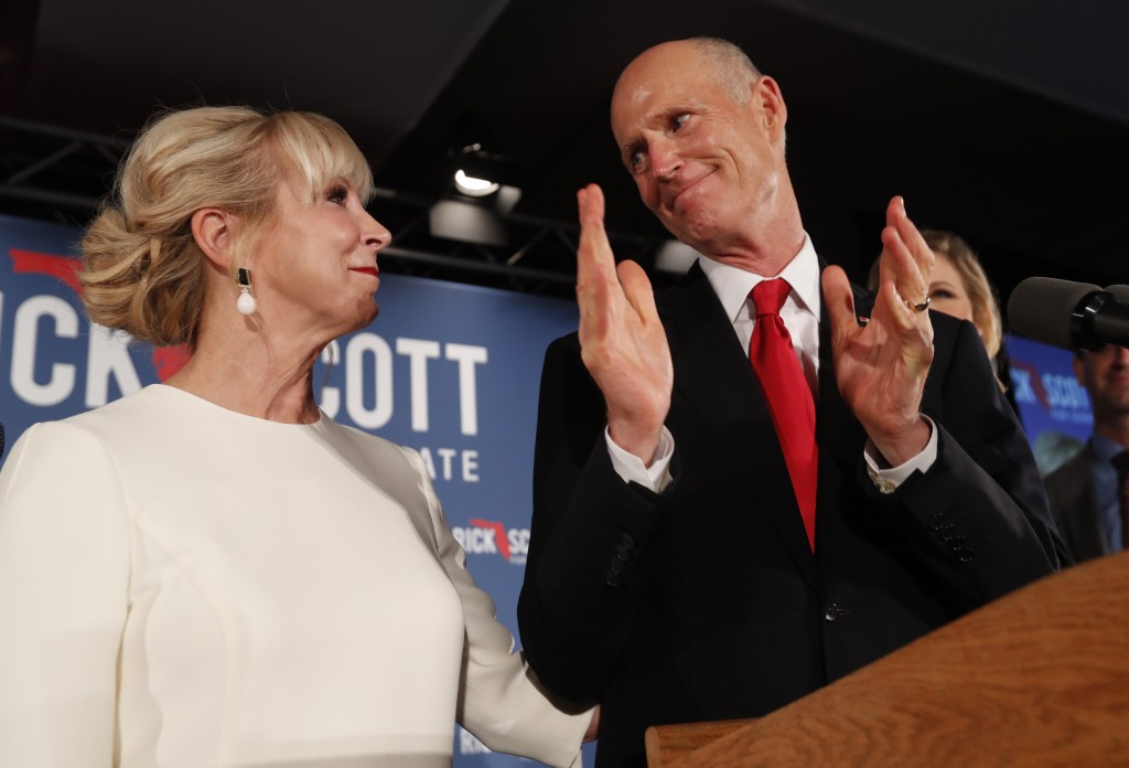 Republican Senate candidate Rick Scott thanks his wife Ann as he speaks to supporters at an election watch party, Wednesday, Nov. 7, 2018, in Naples, ...