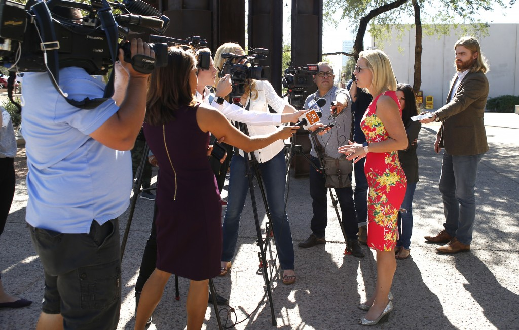 U.S. Senate candidate Kyrsten Sinema, D-Ariz., speaks with the media at the Barton Barr Central Library, Tuesday, Nov. 6, 2018 in Phoenix. Sinema and ...