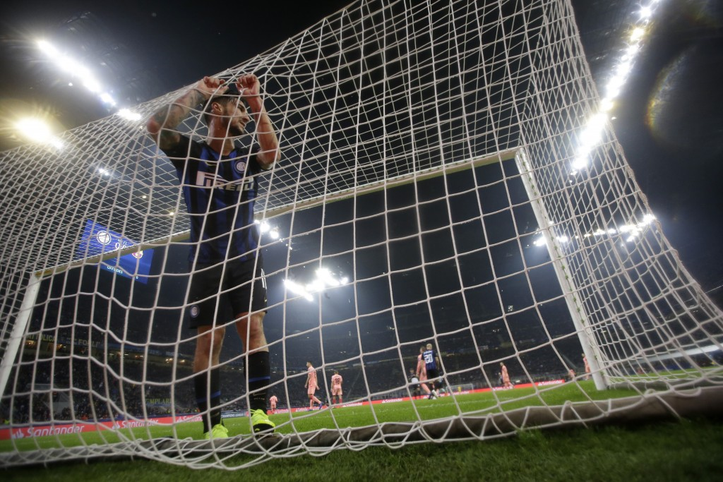 Inter midfielder Matteo Politano reacts after a missed scoring opportunity during the Champions League group B soccer match between Inter Milan and Ba