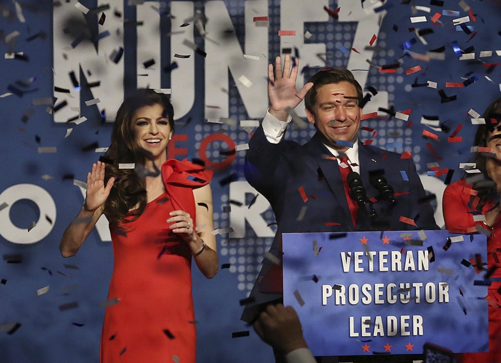 Ron DeSantis and his wife Casey celebrate after winning the Florida Governor's race during DeSantis' party at the Rosen Centre in Orlando on Orlando, ...