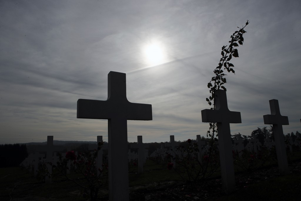 Graves are silhouetted at the cemetery by the Ossuary of Douaumont near Verdun, northeastern France, Tuesday, Nov. 6, 2018 during ceremonies marking t...