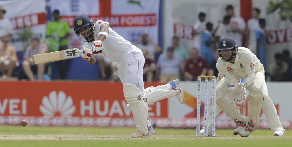 Sri Lanka's Dinesh Chandimal plays a shot during the second day of the first test cricket match between Sri Lanka and England in Galle, Sri Lanka, Wed