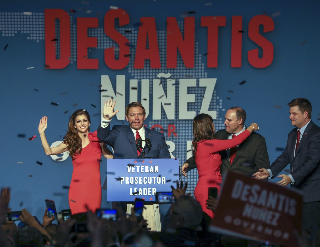 Republican Florida Governor-elect Ron DeSantis, center, waves to the supporters with his wife, Casey, left, and Republican Lt. Governor-elect Jeanette