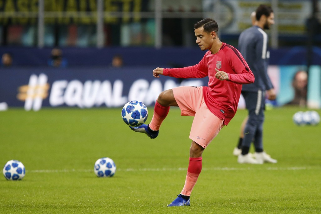 Barcelona's Philippe Coutinho warms up prior to the Champions League group B soccer match between Inter Milan and Barcelona at the San Siro stadium in